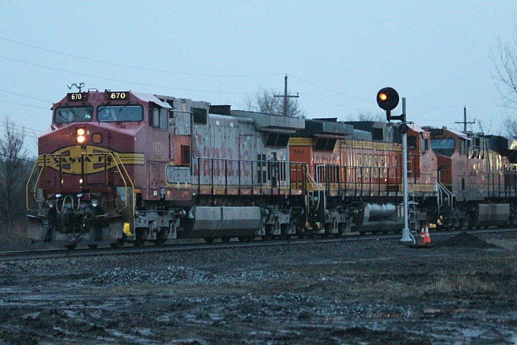 An ATSF Dash9 Warbonnet leading NS 31K in Kankakee IL on t