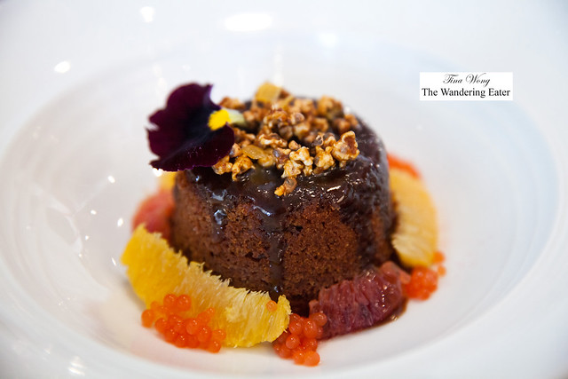Sticky toffee pudding, blood orange and orange segments and pearls