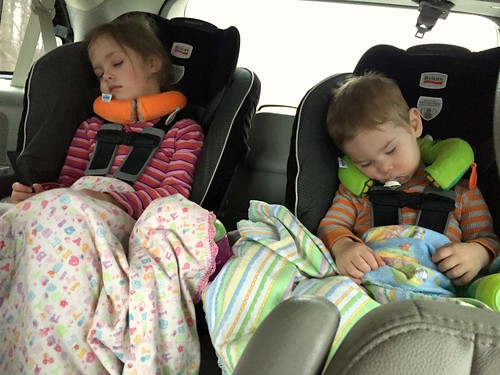kids sleeping on a car trip