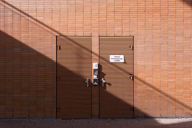 Shadow on two brown doors