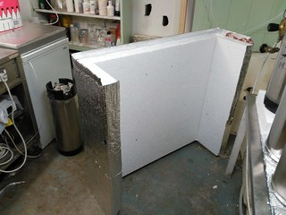 The removable enclosure wall