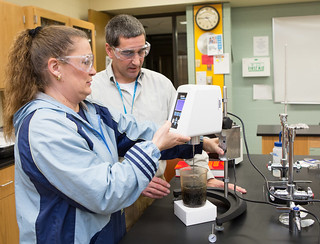 Wed, 01/27/2016 - 16:45 - Bernadette Penkszyk of Batavia performing viscosity on a liquid using the Brookfield viscometer while instructor Greg Sharpe observes.