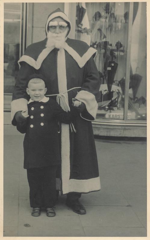 Little boy visiting Santa