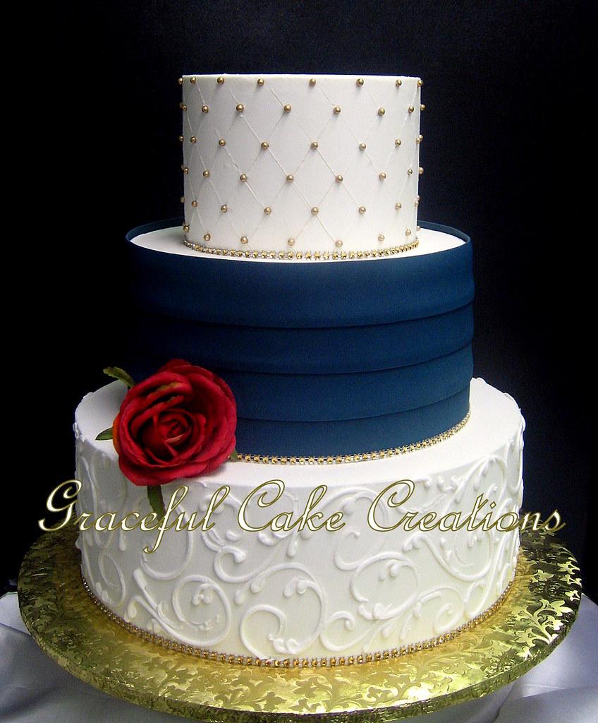 Elegant Ivory Butter Cream Wedding Cake With Navy Blue Ple Flickr