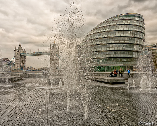 Tower Bridge, City Hall and fountains. London