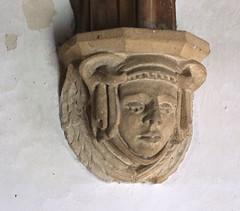 cherub wearing a headdress