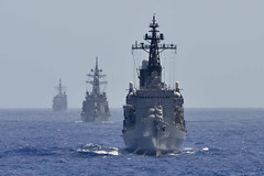 USS Chancellorsville (CG 62), left, and Japan Maritime Self-Defense Force ships JS Harusame (DD102), center, and JS Kurama (DDH144) sail in formation to conduct an air-defense exercise as part of Multi Sail.(U.S. Navy/MCSN Alana Langdon)