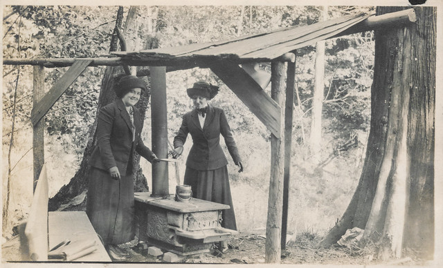 Two women cooking ona camp stove