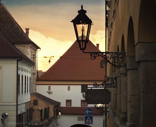 street city travel light sunset urban lamp composition rooftops croatia historic roofs zagreb gaslamp lantern wick lamplighters uppertown gornjigrad kamenita