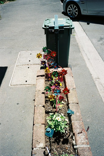 Colourful Pinwheels and concrete
