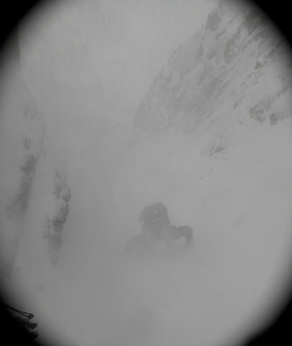 Steve coming up in relentless spindrift to the starting point of Point Five Gully | by Masa Sakano