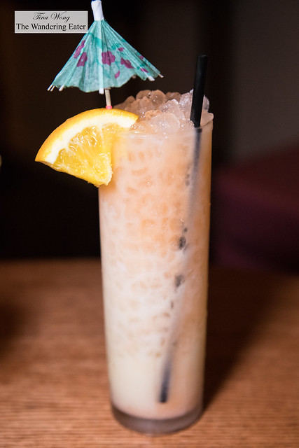 Party Shirt - rum, Aperol, Coco Lopez, pineapple, orange served with pebble rocks