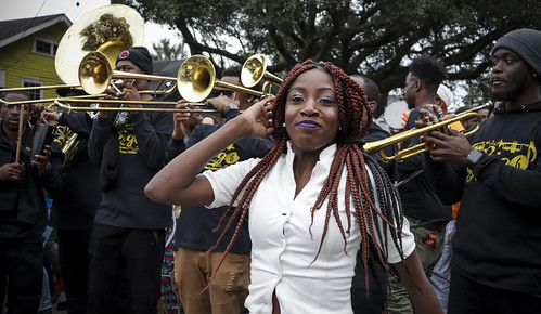 Devastation Divas second line with Big 6 Brass Band. Photo by Jamell Tate.