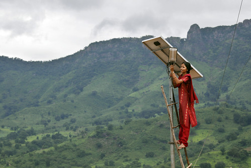 Woman with PV panel high res | by Engineering for Change