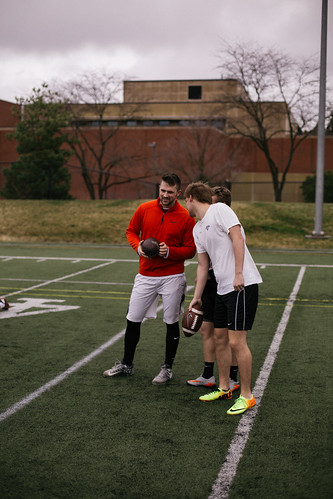 Theta Chi members playing football on the U of I practice field