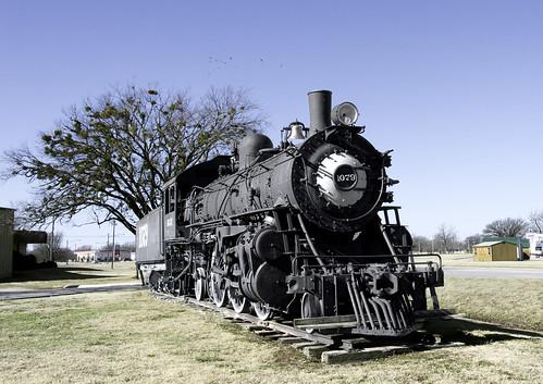 steamlocomotive fadedpaint shadows grass rust utilitypoles wires weathered birds sky baretrees