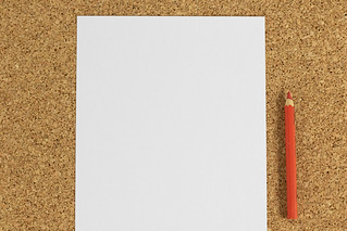 Black white paper with red pencil on cork background | by wuestenigel