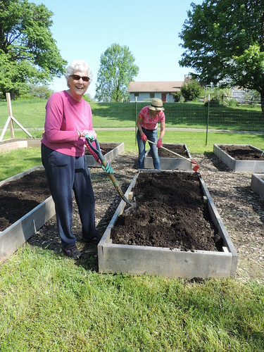 ACNC volunteers work in one of the raised beds built by the Boutwells.