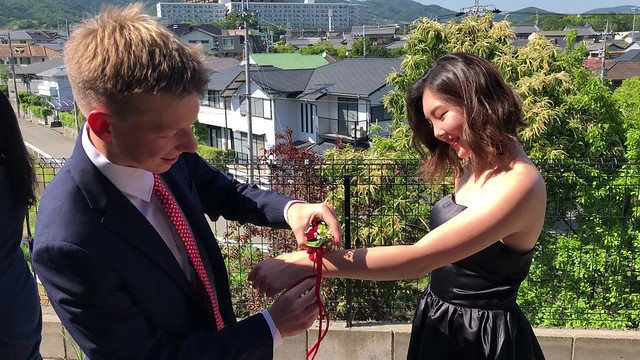 Owen putting on the corsage