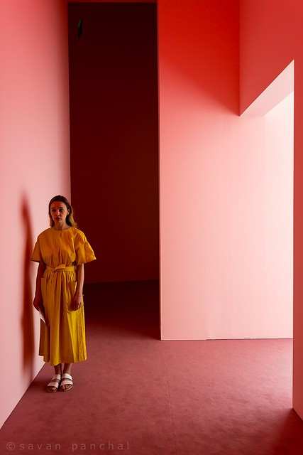 Pink walls and yellow dress.