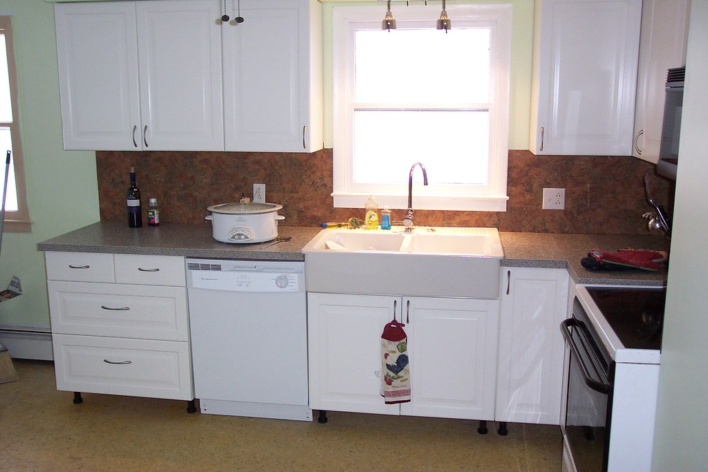 the new IKEA kitchen   There are glass door cabinets on the ...