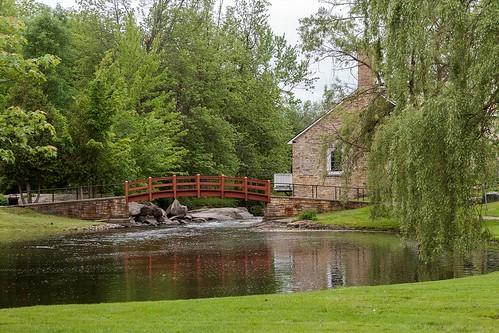 bridge red green scenic scenery perth ontario travel landscape trees building architecture water