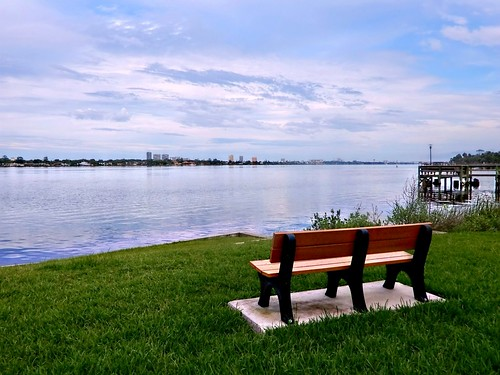 memorialbench amespark june62018 ormondbeachflorida parkbench scenic dock halifaxriver river sky clouds landscape