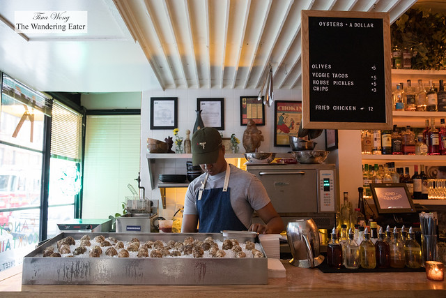 Oyster shucking area at the front of the bar