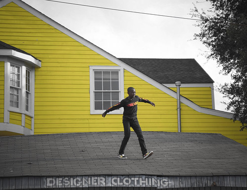 Roof dancing at the second line. Photo by Jamell Tate.