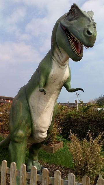 Dinosaur behind fence