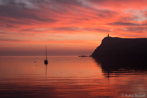 sunset red colour sky sea yacht reflection harbour porterin isleofman braddahead water dusk ocean uk bay boat sailing clouds waves fire fiery bradda tower manx magical evening seaside holiday coast coastal silhouette drama fuji cloudscape