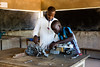 The vocational training centre offers youths 9-month training courses on a specific trade. At the end, trainees receive equipment to set up their own business. In this photo, a young man is supervised by his teacher in the mechanics room, devoted mostly to motorbikes, the most common vehicle in this area of Chad.  © 2018 European Union (photo by Dominique Catton)