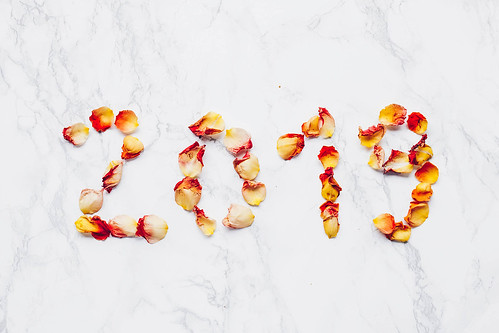 2019 year written with flowers. Rose petals on marble background . | by wuestenigel