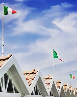 Triangles and flag #sea #flags #italy #italia #triangles #geometry #beach #sky #cabins #colorful #summer #clouds #igers #igersitalia #photooftheday #picoftheday #italy #gurushots | by Mario De Carli