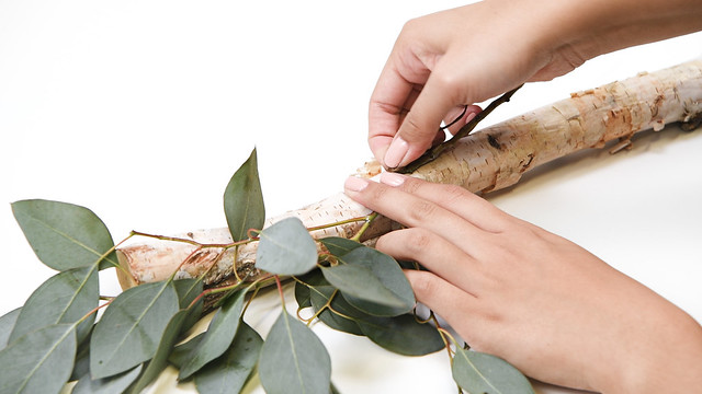 Attaching Greenery to Branch