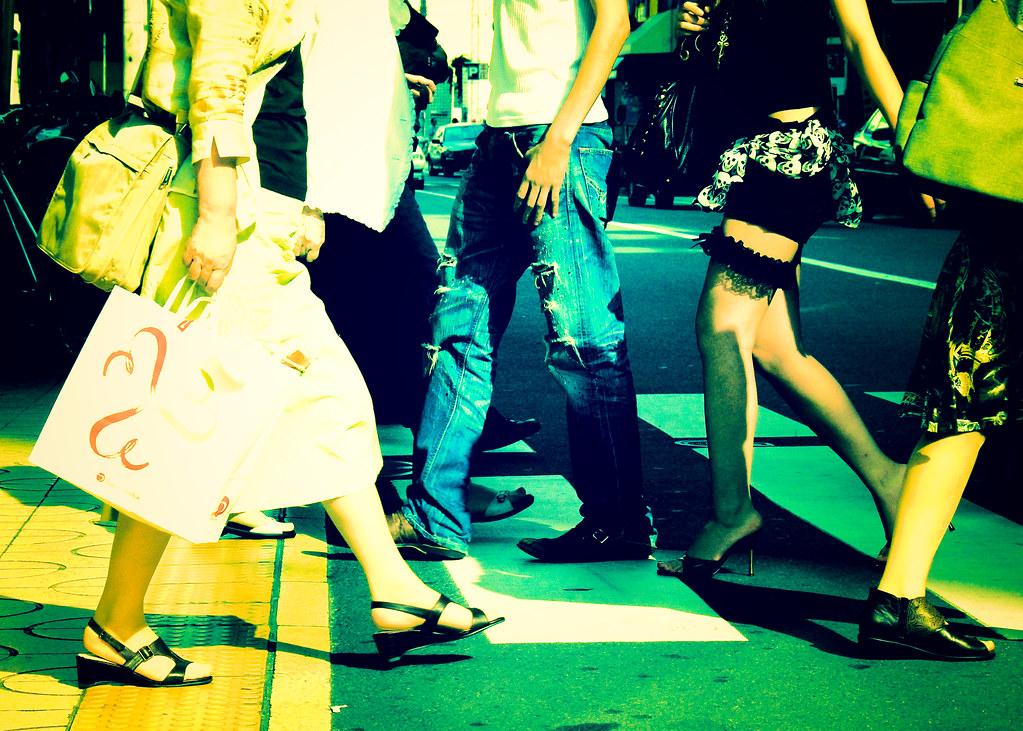 Legs crossing the street by manganite