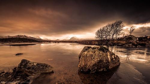 scotland rocks landscape rannochmoor nature sunrise tree clouds highlands glencoe lake snow storm mountains winter stormy