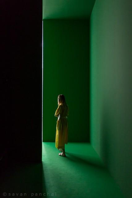 Green walls and yellow dress.