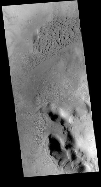 Dunes and glacier flows in Moreux Crater (THEMIS_IOTD_20180530)