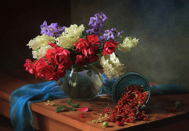 Still life with flowers and berries