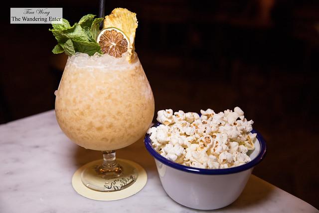 Truffled popcorn and Wonder Woman- Yagara cachaça, Don Q añejo rum, allspice dram, curaçao, lime juice, pandan passion cordial