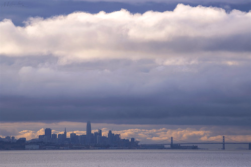 sanfranciscoskyline sealpoint sanmateo northerncalifornia sanfrancisco cityscape dusk seascape bay ngc bayarea wave ocean shore seaside coast california westcoast pacificocean landscape outdoor clouds sky water rock mountain rollinghills sea sand beach cliff architecture building baybridge