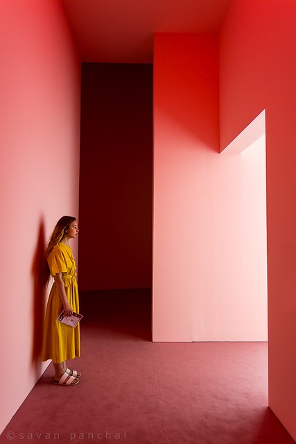 Pink wall and yellow dress.