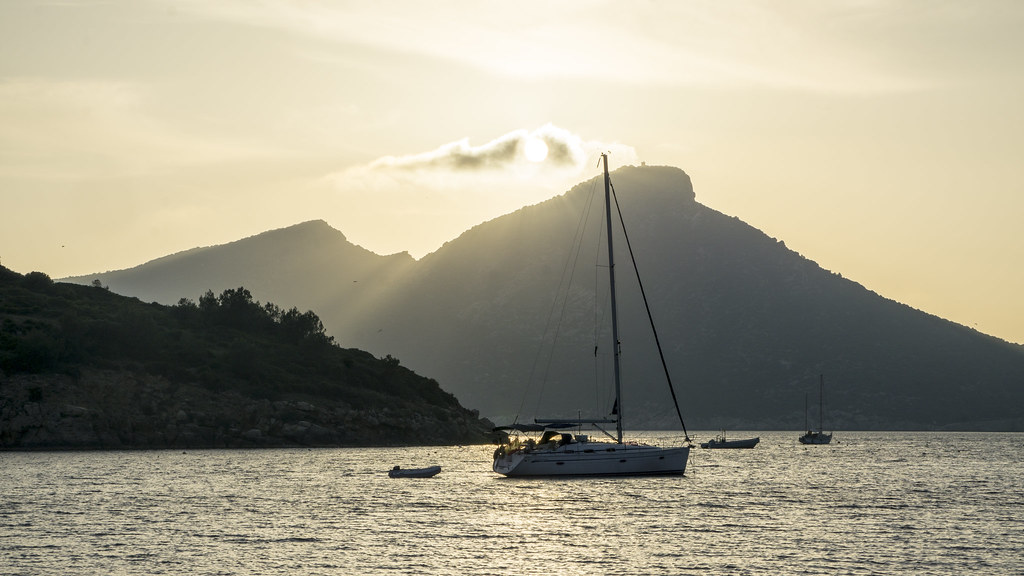 Sailboat at Sunset in front of a mointain
