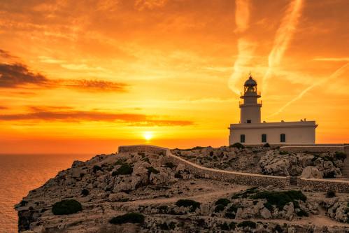 lighthouse menorca spain sunrise sun rocks island balearic sea waterscape limestone cliff landmark rocky coast cabodecavalleria