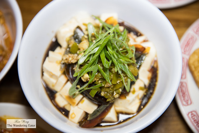Naughty tofu - House made vinegar sauce mixed with chopped tofu, century egg, long hot pepper, fresh garlic paste and scallions