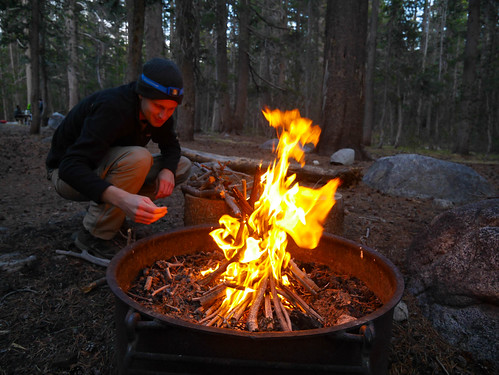 Miles tending fire at Tuolumne BP camp the night before we head out | by snackronym