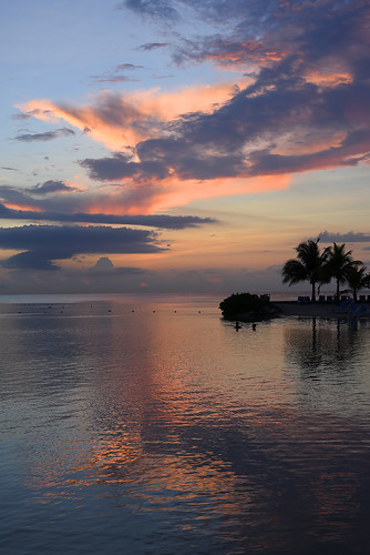 jamaica westindies caribbean mobay montegobay beautiful pretty lovely gorgeous sunset evening clouds sky water ocean caribbeansea ripples reflections palmtrees peopleswimming sundaylights peaceful tranquil placid