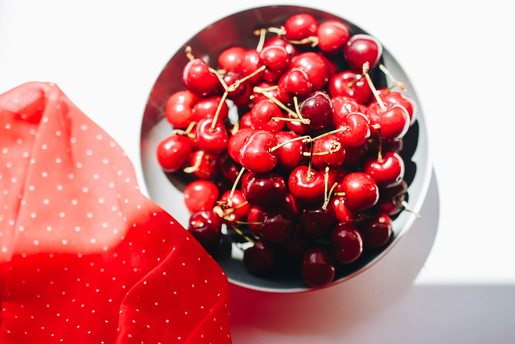 Top view of fresh cherries in a bowl with red fabric | Flickr