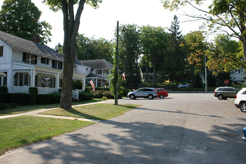 petoskey michigan north northern resort city town late summer early autumn fall 2012 1810 woodlandave bluffst intersection woodland bluff beautiful houses cottages front porch american flag neighborhood light shadow bayview
